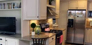 kitchen with gas stove and range hood