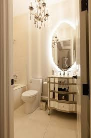 french bathroom with mirrored sink vanity