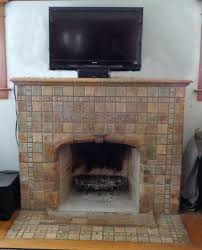 pull down tv mount over fireplace uk into stone tv mounted above