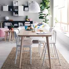 dining room sets ikea: a bright dining area with a dining table in ash veneer and four white dining chairs