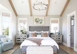 Bedroom. This master bedroom features textured gray wallpaper ...
