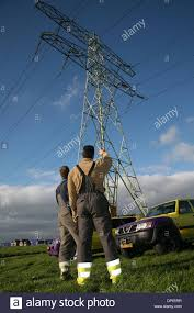 electrical power line installers and repairers dutch electrical power line repairers at work stock photo 65289835