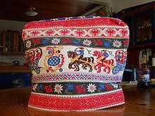 Tea cosy - Wikipedia & A traditional German tea cosy made of quilted fabric with folk art patterns Adamdwight.com