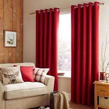 Featuring a deep red tone and a woven texture, these eyelet curtains offer  a smooth