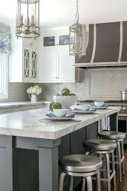 white kitchen cabinets black countertops backsplash inspiring