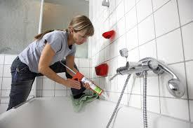 bathroom remodel do it yourself. Woman Caulking Tile Around Bathtub 134469710 Bathroom Remodel Do It Yourself O