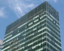 building an office. Curtain Wall Of An Office Building, Composed Mainly Glass Panels And Metal Beams. Building