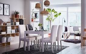 a beige black and white dining area in an open plan living e with chair