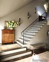 stairway decorating ideas via house beautiful tall staircase wall decorating ideas