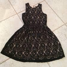 Black lace dress over nude fabric