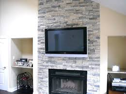 nice stone veneer fireplace design featuring wall mount flat surround interior