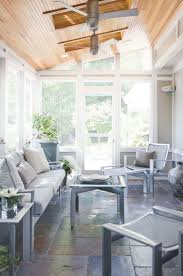 modern sunroom furniture. Fine Furniture Beautiful Neutral Screen Porch With Fans And Stone Flooring In Modern Sunroom Furniture N