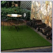 synthetic designed to replicate outdoor woven grass rug