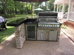 kitchen outdoor kitchen storage creamy ceramic tile floor built in oven wooden laminated countertop metal
