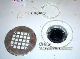 how to remove tub drain cover