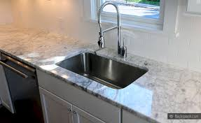 white countertop with subway tile backsplash white large porcelain tile kitchen countertops