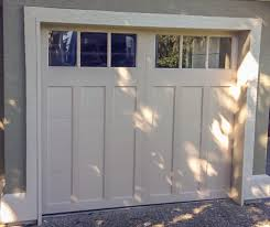 beautiful clopay coachman garage doors in model cd13 rec13 windows sandtone base and overlay coachman doors are a great way to transform your home