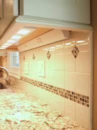 plug in cabinet lighting. details under cabinet lighting light rail molding color matching trim plates plug mold outlets strips pencil edge for tile decorative door in