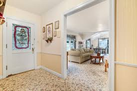 front entry with view into the living room previous owners installed a very expensive wool carpet which can be d to fit your home decor