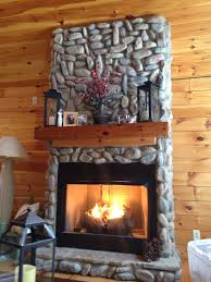 rock fireplace warm blanket loving our new home fire rock fireplace