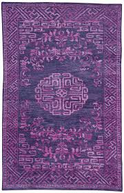 this vibrant and stunning royal purple rug is inspired by a 19th century chinese carpet the dasia rug has an aged and richly dyed patina which gives the