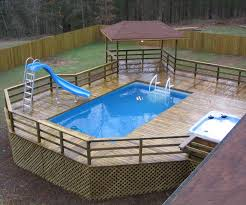 above ground pool slide. Interesting Above Swiming Pools Above Ground Pool Deck Design With Spa Also Slide  And Wooden Fence Besides Hand Rails Flooring  In T