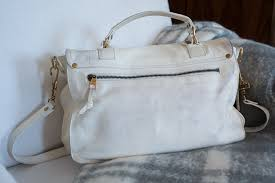 how to clean white leather handbag handles