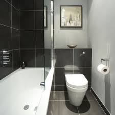 Small and sleek. The black glossy wall and floor tiles and the recessed WC  work very well in this narrow bathroom. Image from 25 Beautiful Homes