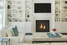 living room with floor to ceiling built in shelves