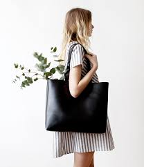 with a natural suede leather interior this large black tote is perfect for carrying heavy items