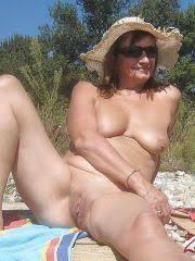 Still Sexy Mature Woman Sunbathing Naked