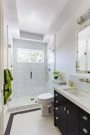 black washstand with white hex tiles