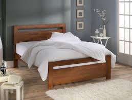 Semi rustic wood bed frame with simple headboard white bed linen white  bedcover and white pillows