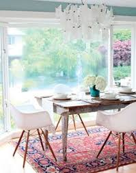 love this eclectic dining room the eames chairs rustic dining table and traditional rug are perfect together eames for rob