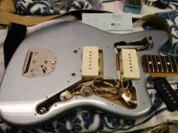 the jazzmaster and jaguar page at the right is an example of an ice blue metallic us vintage reissue jazzmaster the pickguard removed note the color coded wires and the brass