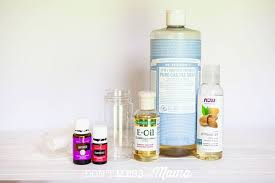 close up of bottles of essential oil castile soap vitamin e oil and
