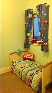 transport toddler cot bed nursery bedding set with matching curtains and cushion dunelm