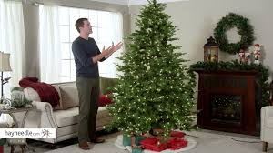 7.5 ft. Feel Real Nordic Spruce Hinged Christmas Tree - Clear ...