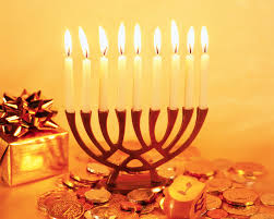 what is hanukkah gelt teenager lighting hannuka candles