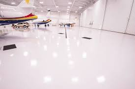 epoxy flooring. White, Light Reflective Flooring Is Standard In Aviation Hangars. Epoxy