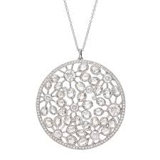 circular shaped diamond pendant designed with oval shaped rose cut and round brilliant cut diamonds set in an openwork foliate pattern within a pavé