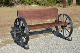 Sycamore Creek Crations. Walnut bench with black painted wheels.