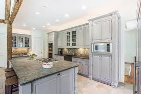 this kitchen is 26x13 338 sq ft the chef s kitchen has hand crafted cabinets top of the line appliances brushed granite counters wet bar ice maker