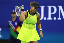 Naomi Osaka throws racquet and hits ...