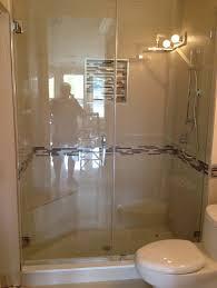 fine folding framless glass shower door with soothing shower lighting design