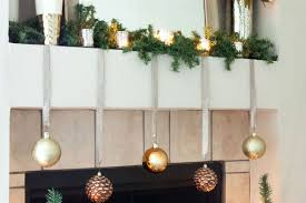 Simple and Elegant Christmas Mantel Decorations: Garland, Tealights, and  Ornaments Hanging from Ribbon