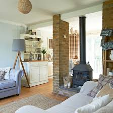 Open plan living room with double sided wood burner