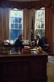desk in oval office. President Ronald Reagan Talks To Senator Dan Quayle At His Desk In The Oval Office Of White House Washington D.C.
