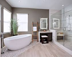 Create your very own spa in your bathroom using pebble rock flooring  combined with ceramic wood