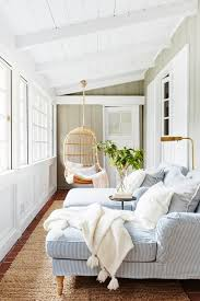 Enclosed Porch With Striped Armchairs